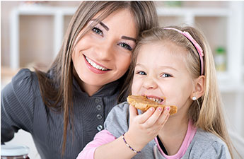 mom and daughter eating a bagel